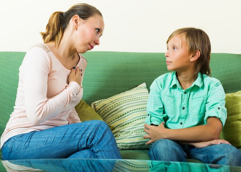Mother with  teenager son having serious conversation